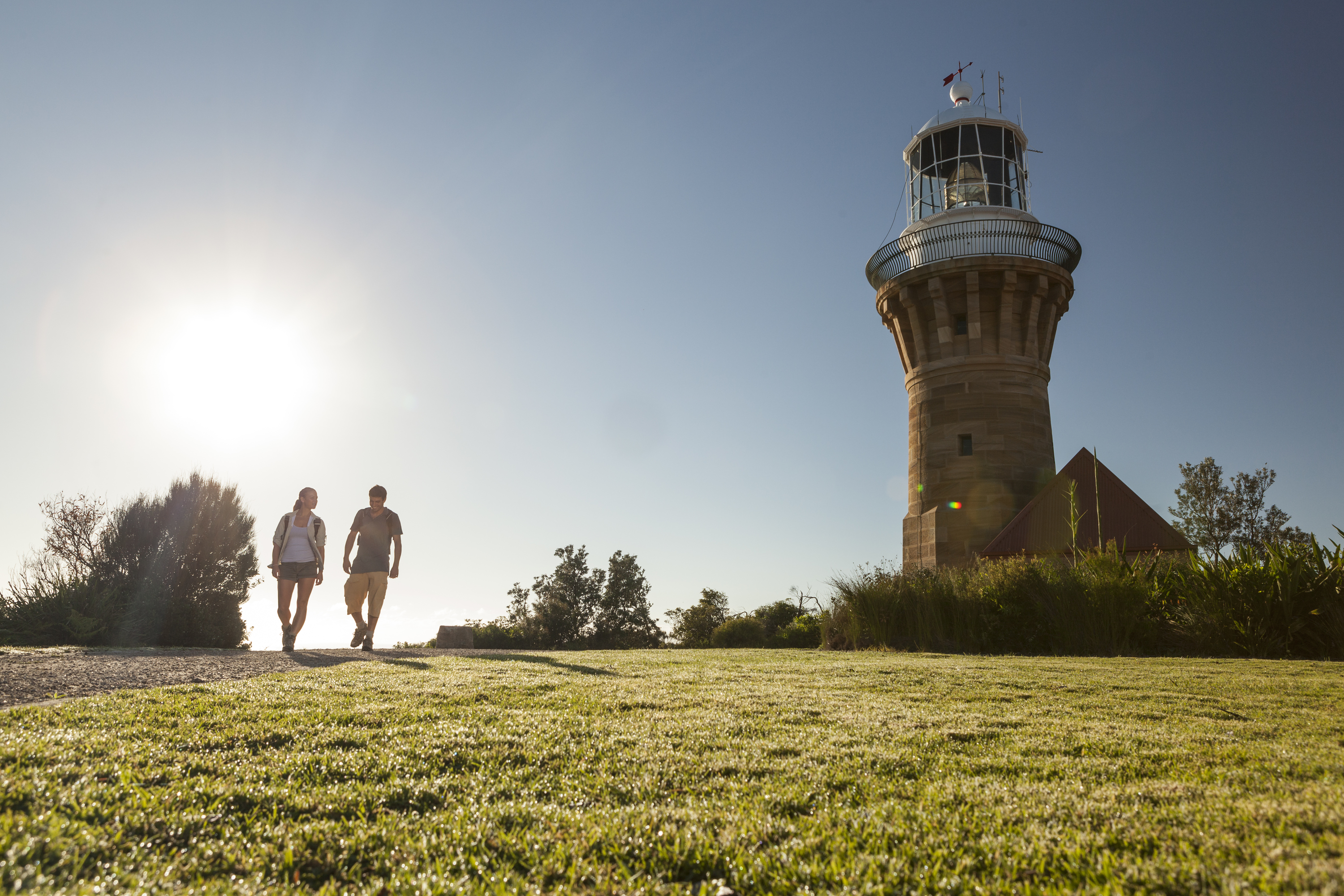 People walking in the sun at Barrenjoey Lighthouse.