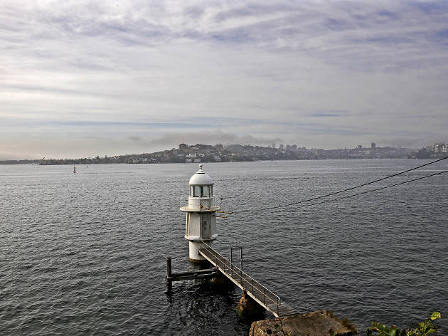Bradleys Head lighthouse on the edge of a jetty.