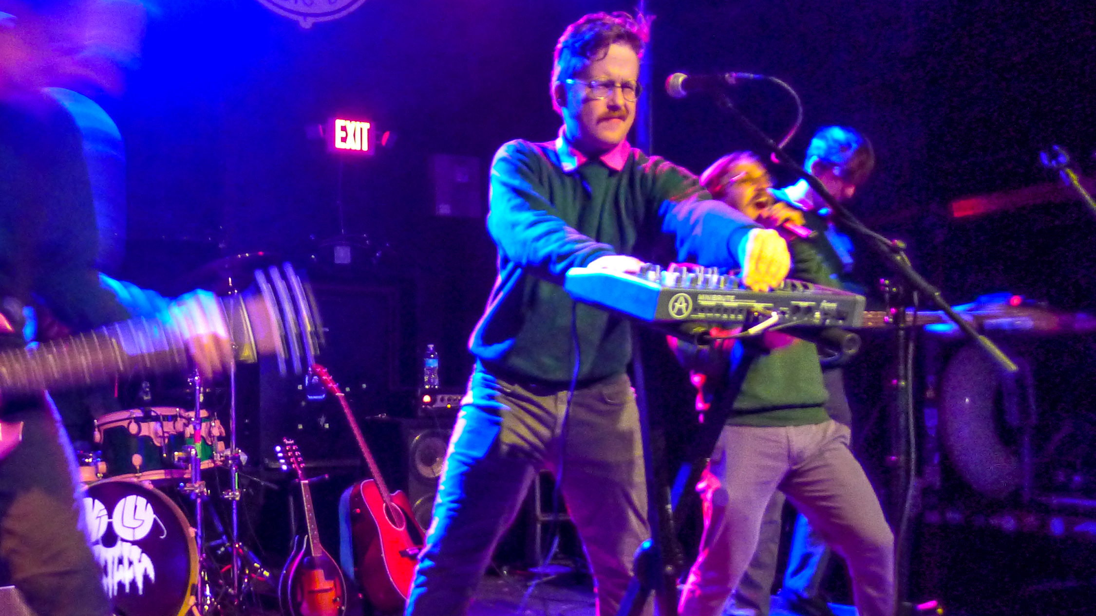Men dressed as Ned Flanders playing enthusiastically on stage