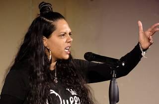 Poet and writer Melanie Mununggurr-Williams speaks into a microphone.
