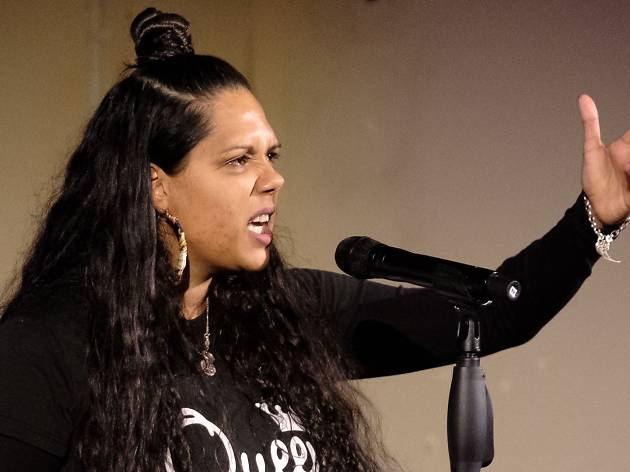 Poet and writer Melanie Mununggurr-Williams speaks into a microphone.