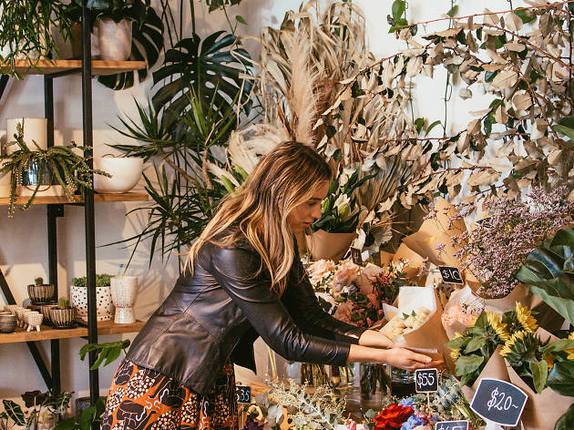 Woman looking at flowers in Wild Forager store Sydney
