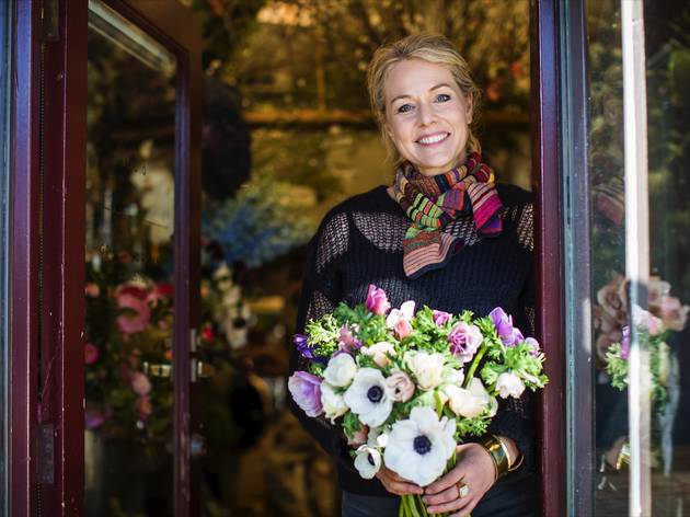 Person holding boquet of flowers at Grandiflora Florists