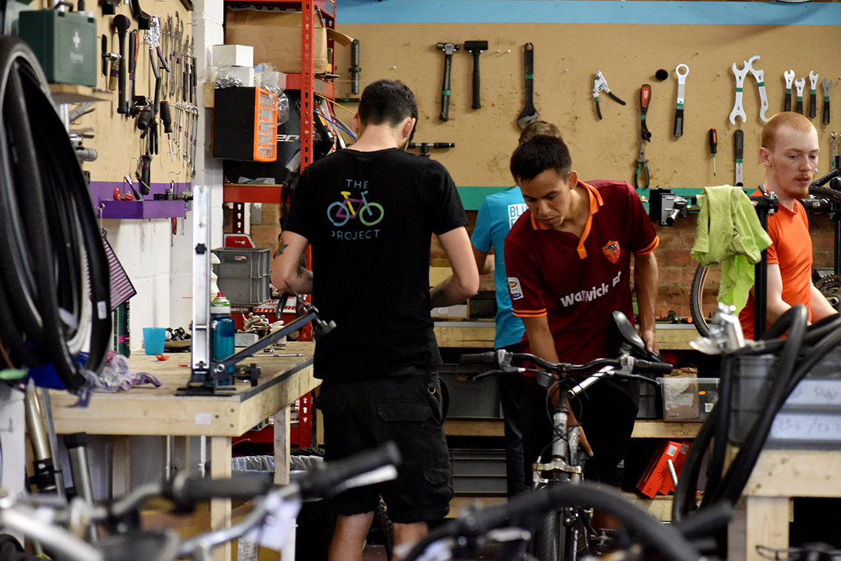 Volunteers at The Bike Project Charity in London fix bicycles for refugees.