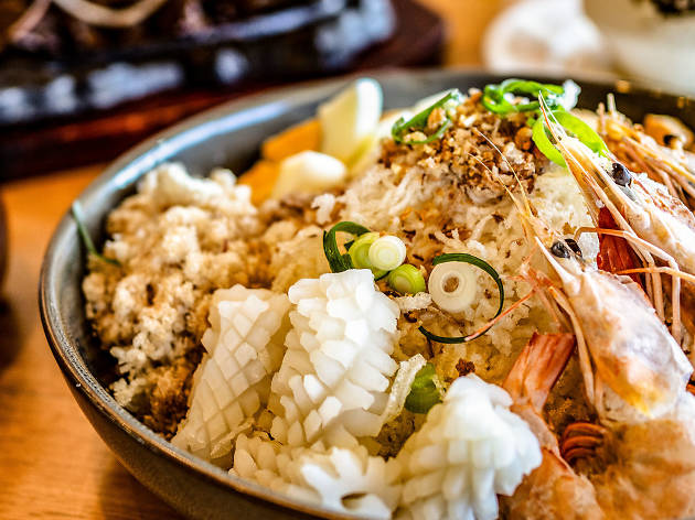 Bowl of seafood fried rice and other dishes at Kasalo