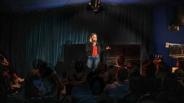 Comedian on stage at Lido Comedy Club
