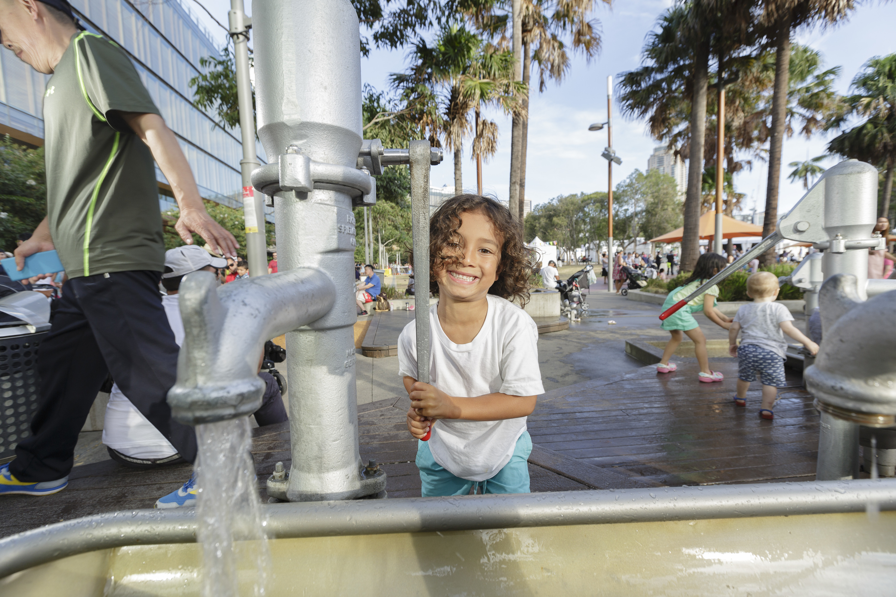 Child pumping water at the Darling Quarter playground in Sydney
