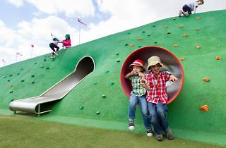Kids playing at Blaxland Riverside Park, sticking out tongues