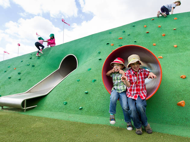 Kids playing at Blaxland Riverside Park, sticking out tongues