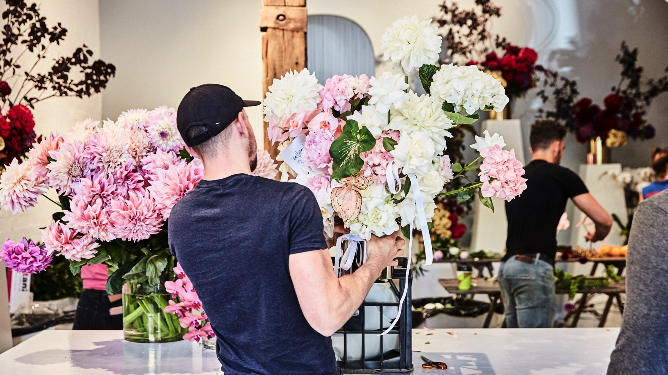 Person making boquet at Hermetica Flowers Florists