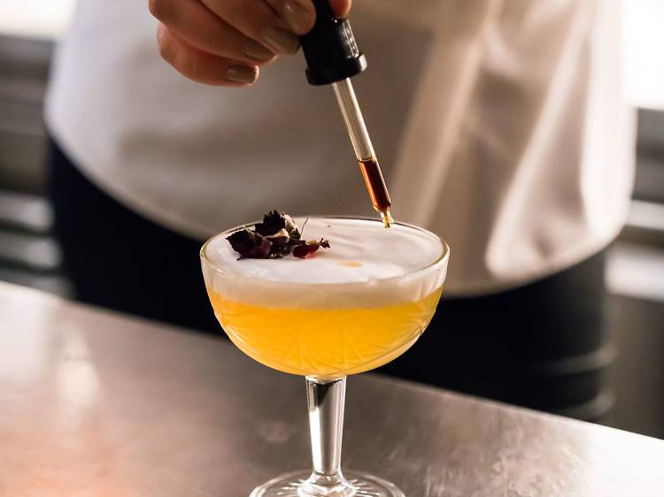 Sip cocktails at Azur Bar