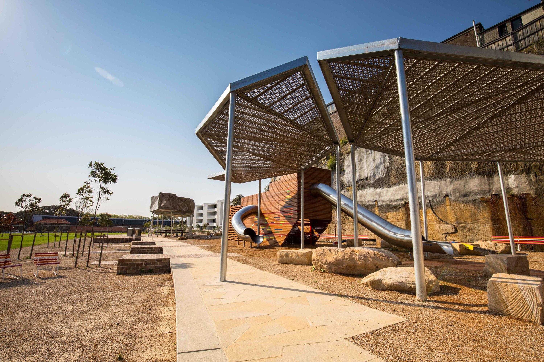 Harold Park playground with slide, shelter and sandstone boulders