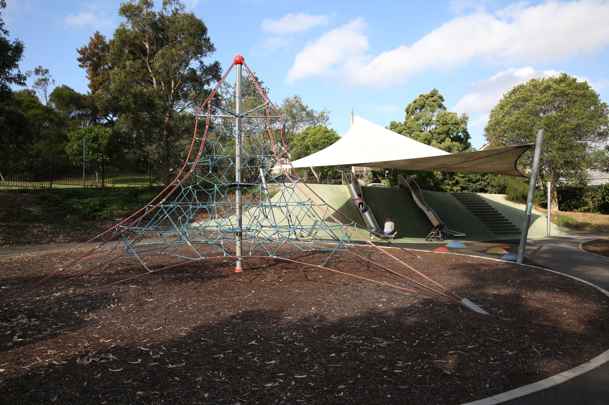 Climbing net and slides at playground on the Bay Run
