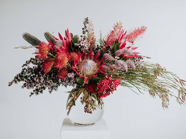 Flowers in a vase with a white background