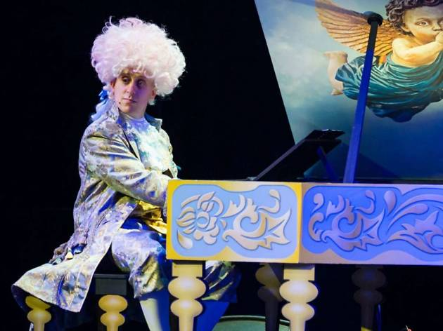 A kid's performance about Mozart, with the acting playing him sitting at a piano on stage.