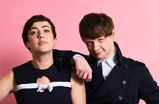 Razzmatazz DJs Caity and Ted against a pink backdrop
