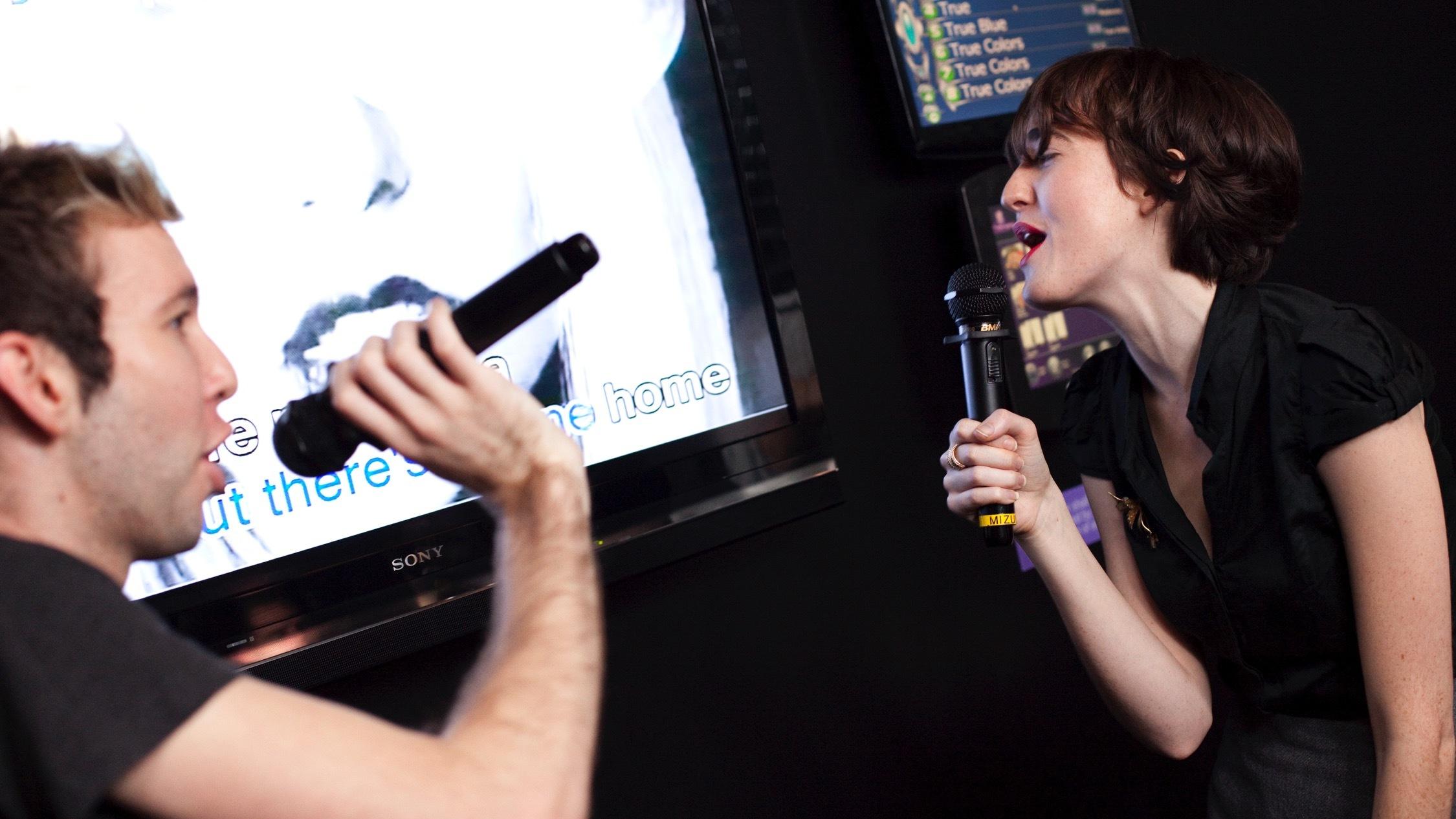 People sing in karaoke room at Mizuya Karaoke