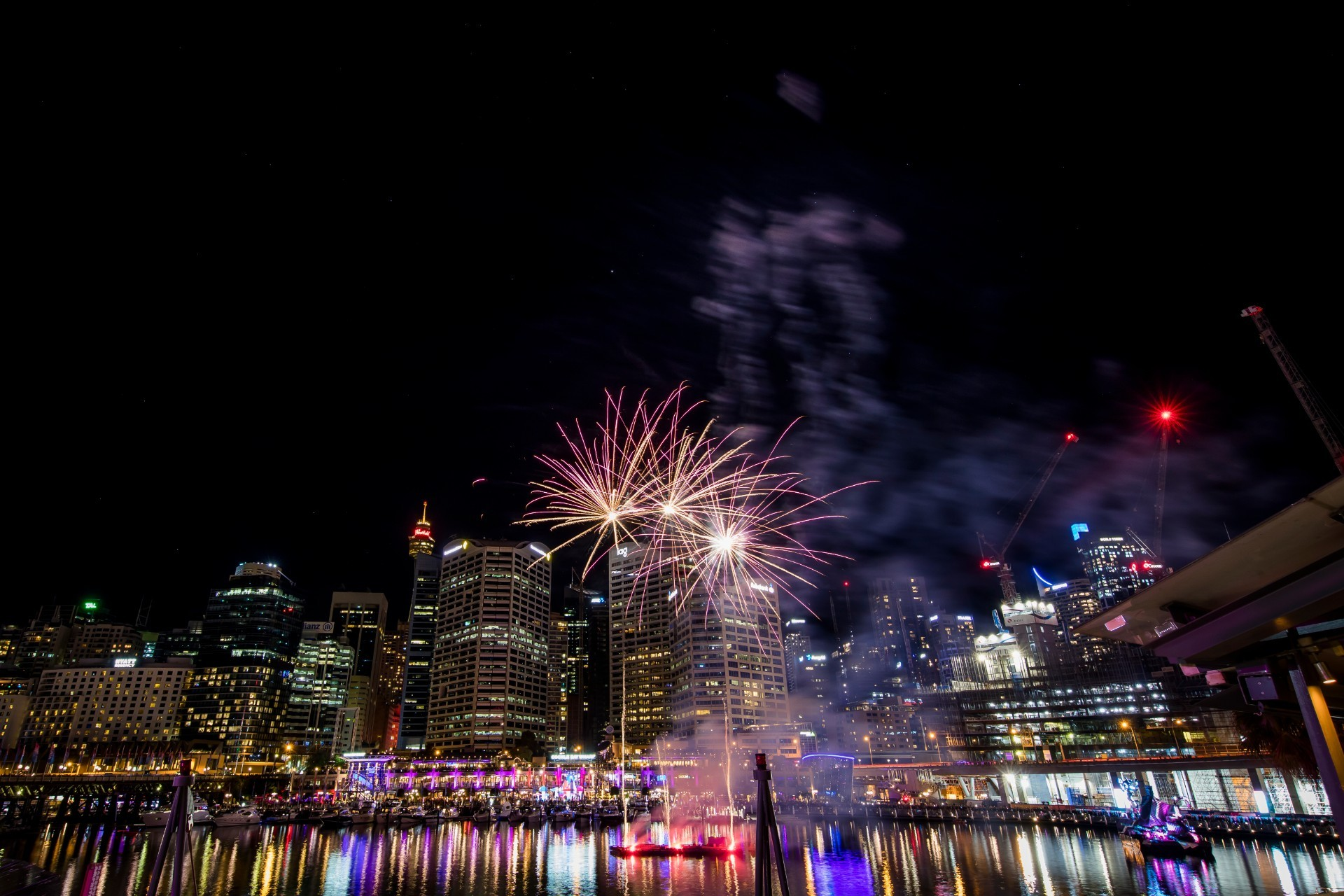The city skyline view from Darling Harbour with fireworks.