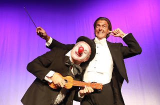 Characters in suit costumes for children's show the Conductor and the Clown.