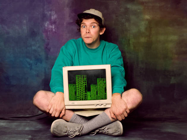 Actor from theatre show Tröll sits with a computer screen