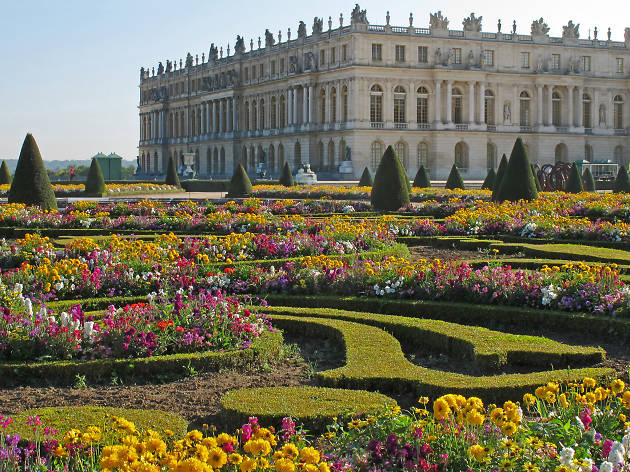A view of the château de Versailles across the flower gardens