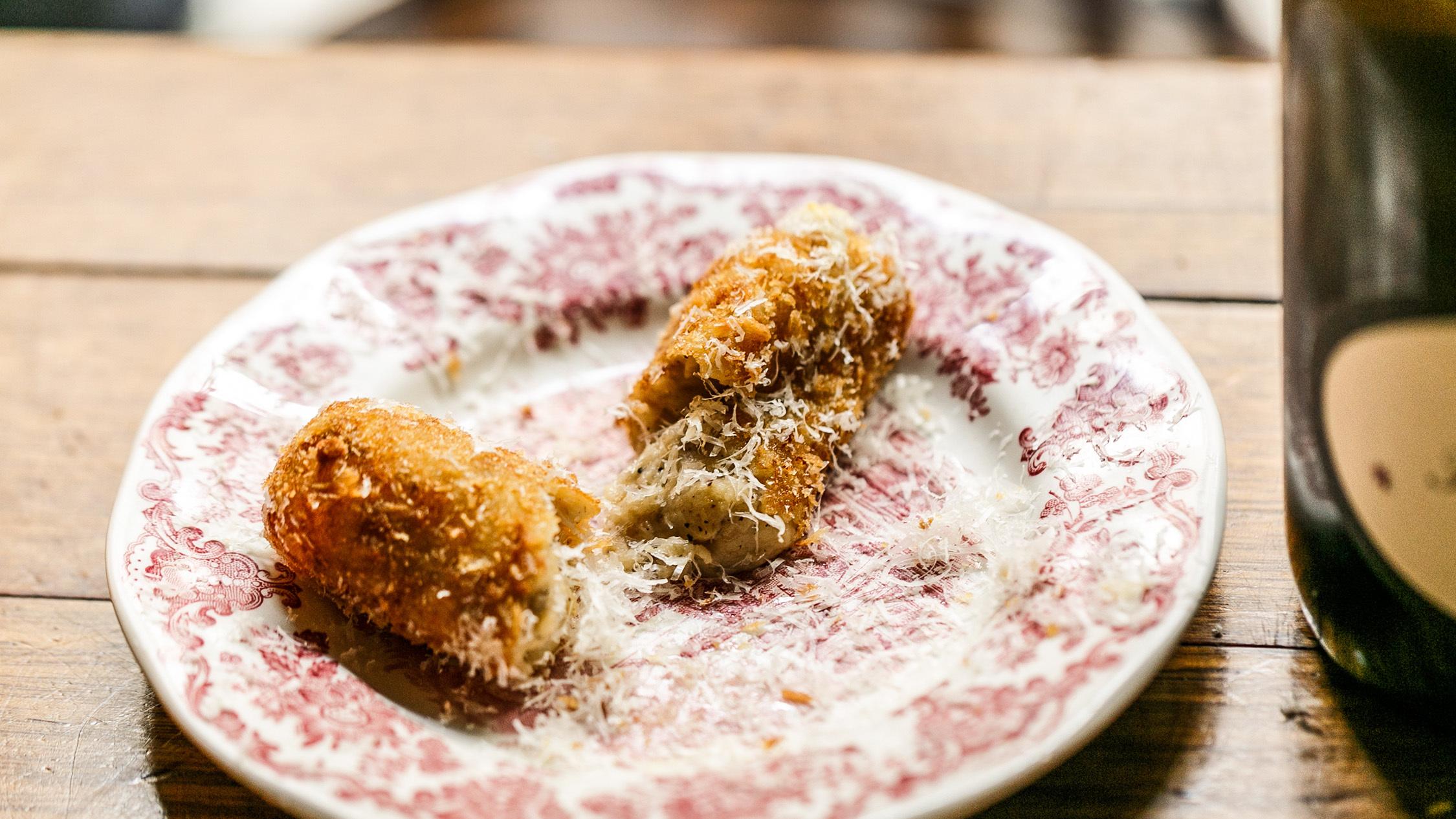 cacio e pepe croquette at Pinotta
