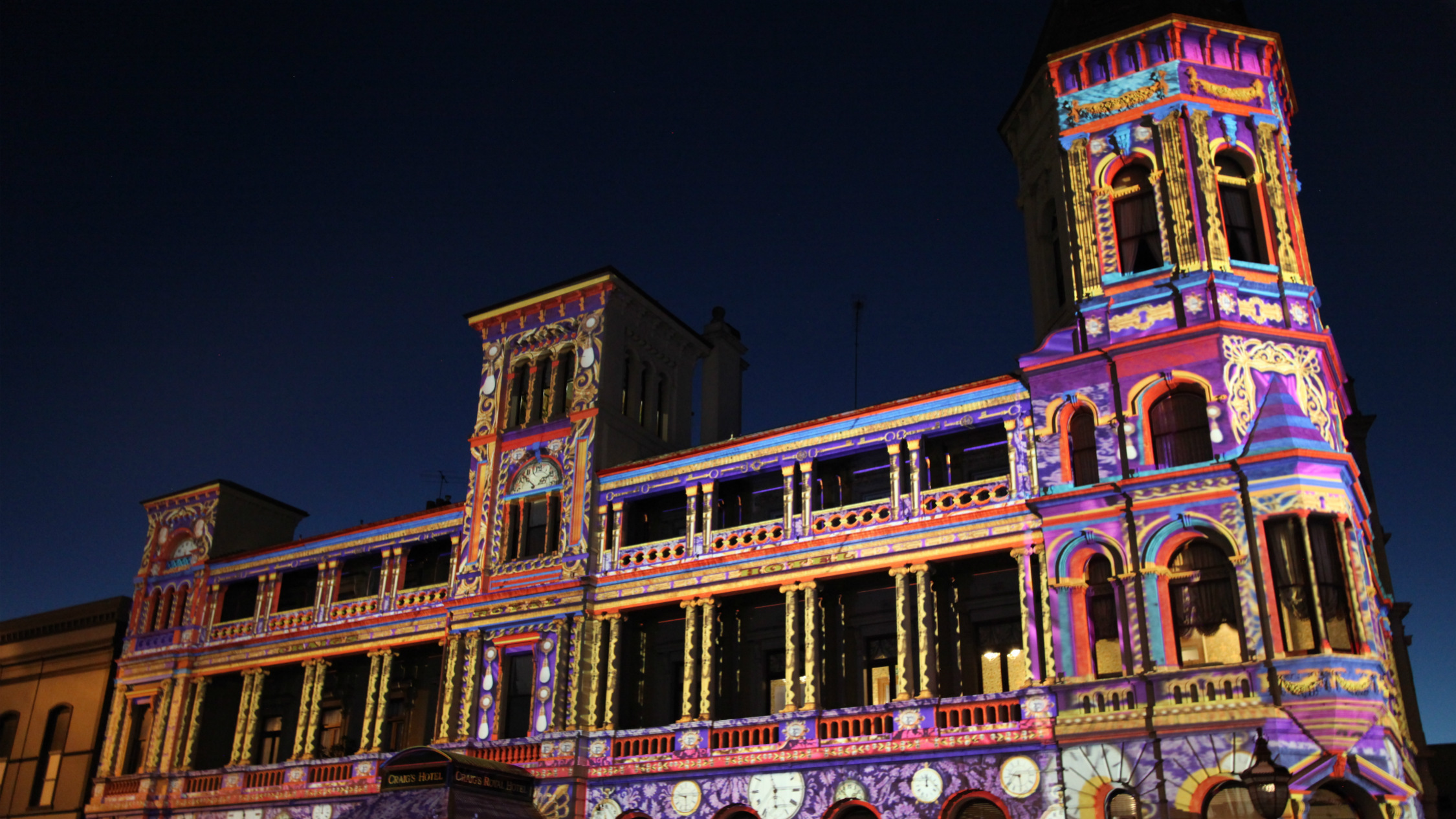 Craig's Hotel in Ballarat overlaid with colourful projection art as part of White Night Ballarat