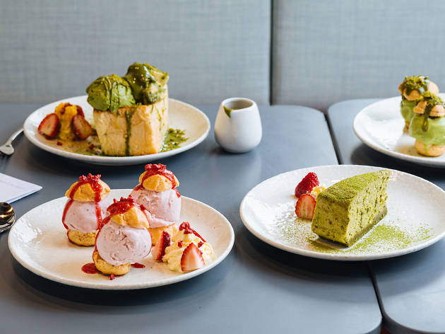 Matcha and strawberry desserts on the table at DOPA Don and Milk Bar