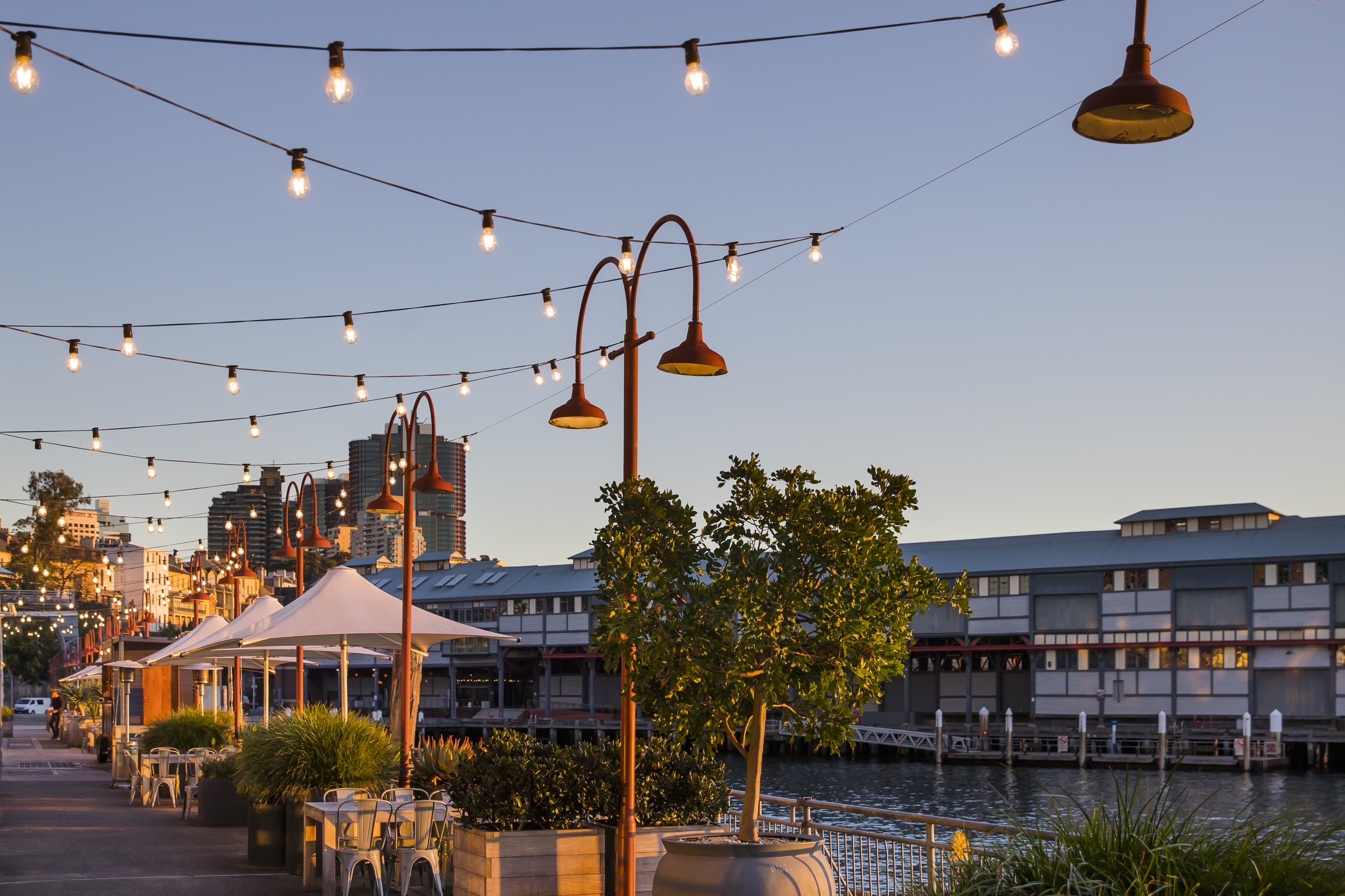 Tables by the water at Pier One Sydney Harbour.