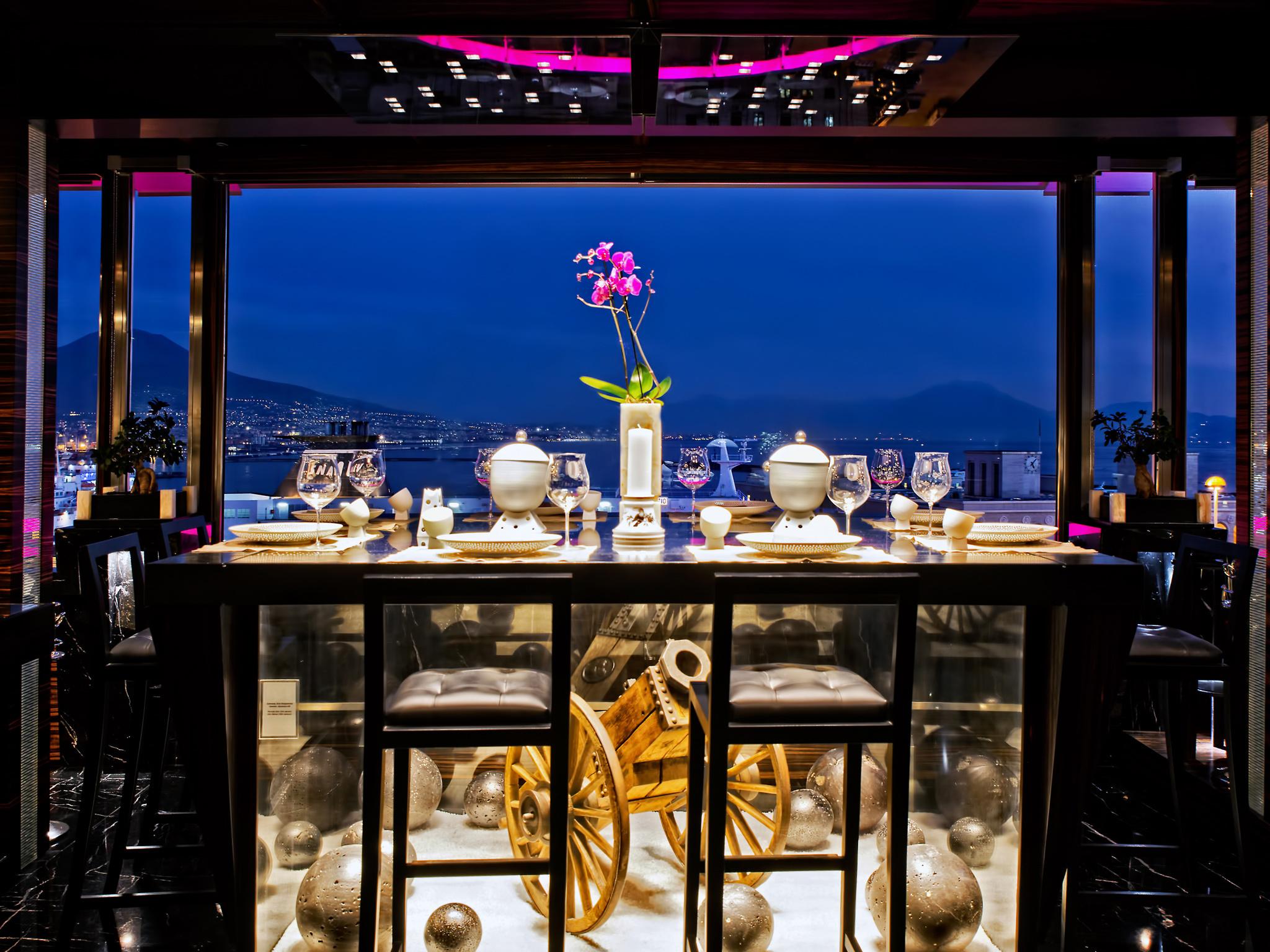 The interior of Michelin-starred restaurant Il Comandante at Hotel Romeo in Naples