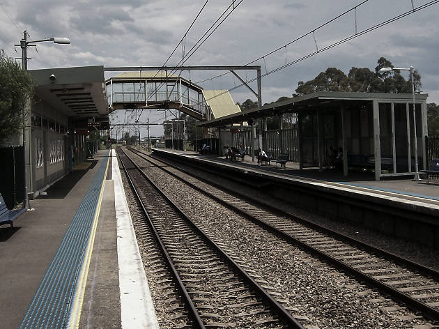 The tracks at daytime at Macquarie Fields Train Station.