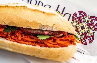 A pork banh mi resting on a bag at Hong Ha bakery