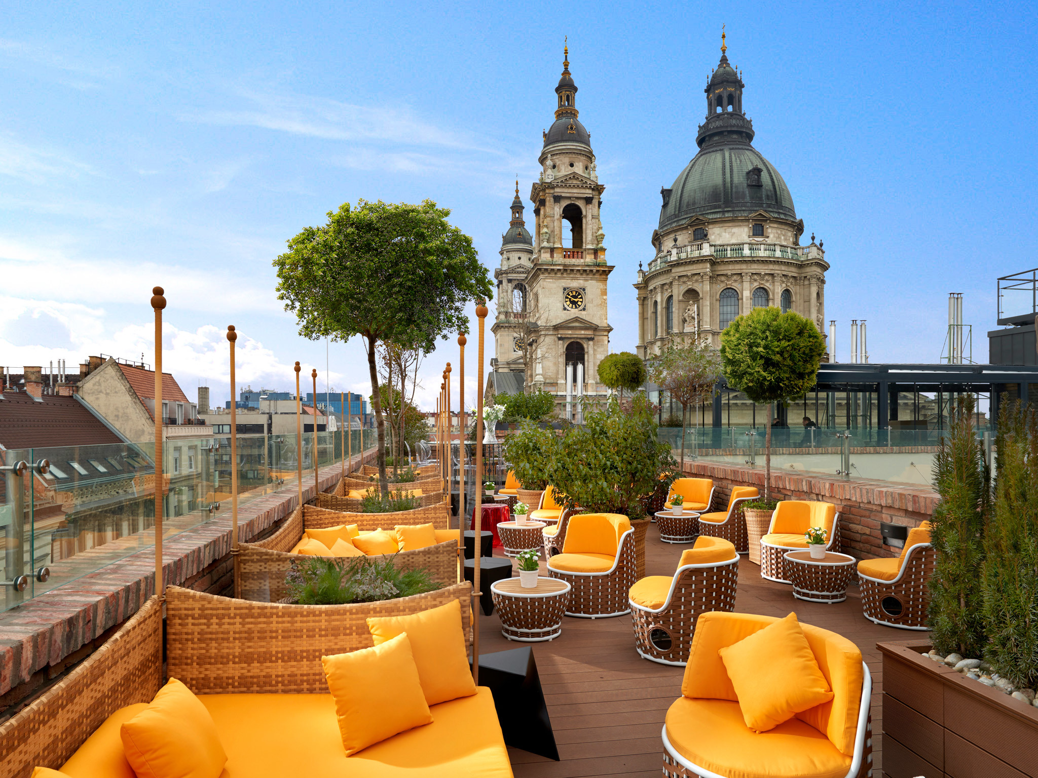 The rooftop bar at Aria Hotel with St Stephen's Basilica behind