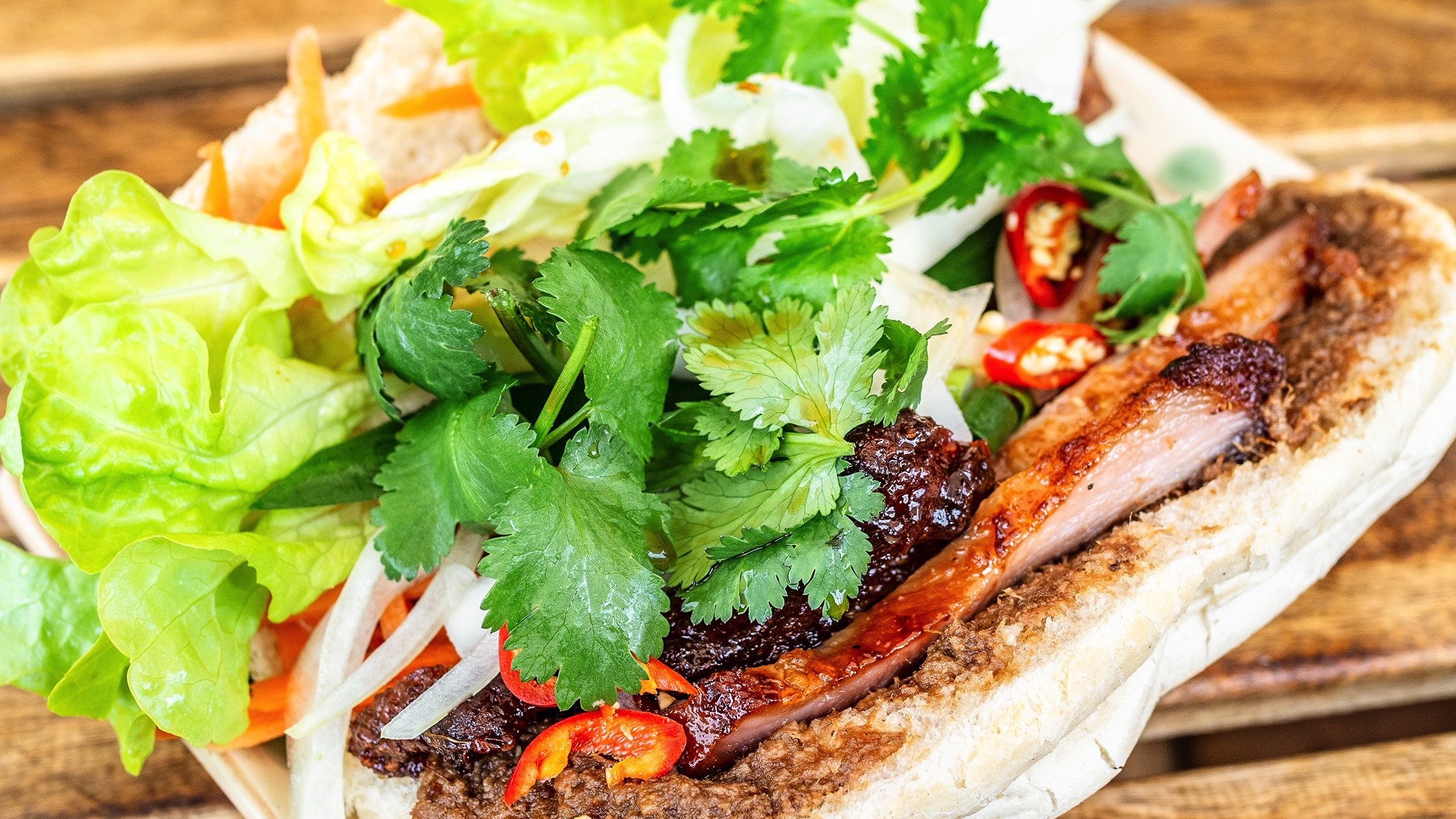 Banh mi sliced in half at Alex 'N' Rolls