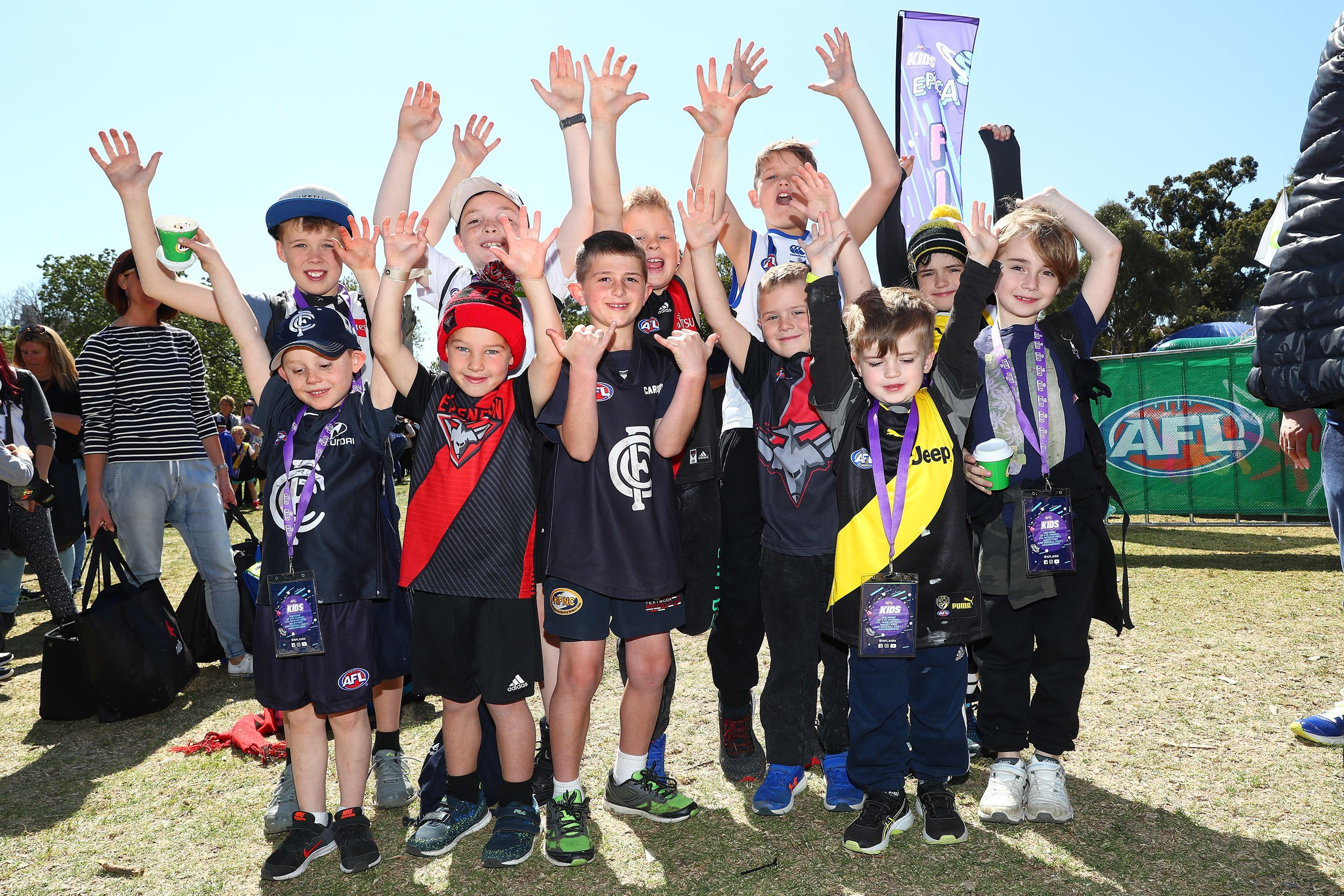 Kids in footy colours at the 2018 AFL Footy Festival at Yarra Park