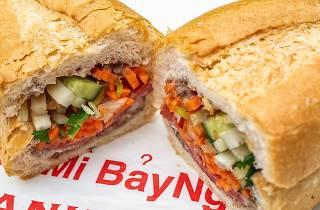 A banh mi sandwich sliced in half at Banh Mi Bay Ngo