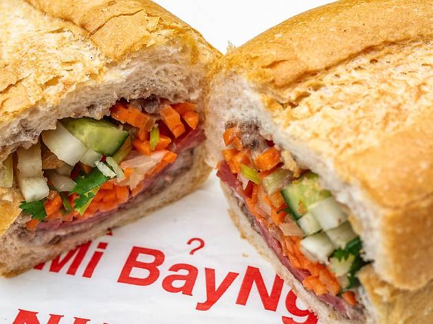 A banh mi sandwich sliced in half at Banh Mi Bay Ngo