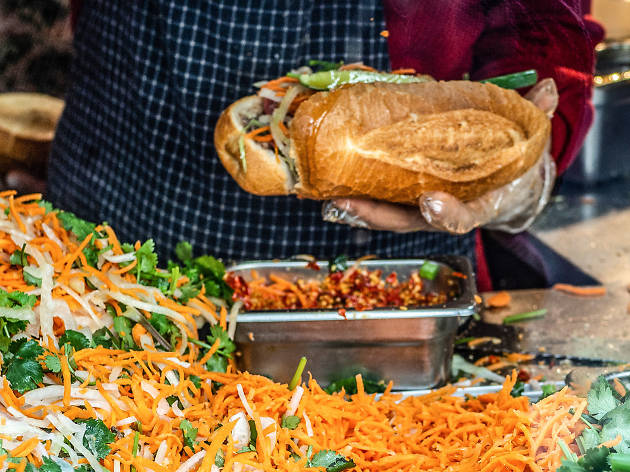 Staff making banh mi sandwiches at Marrickville Pork Roll