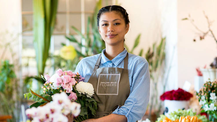 Woman holding a bunch of flowers from Amazing Graze flowers