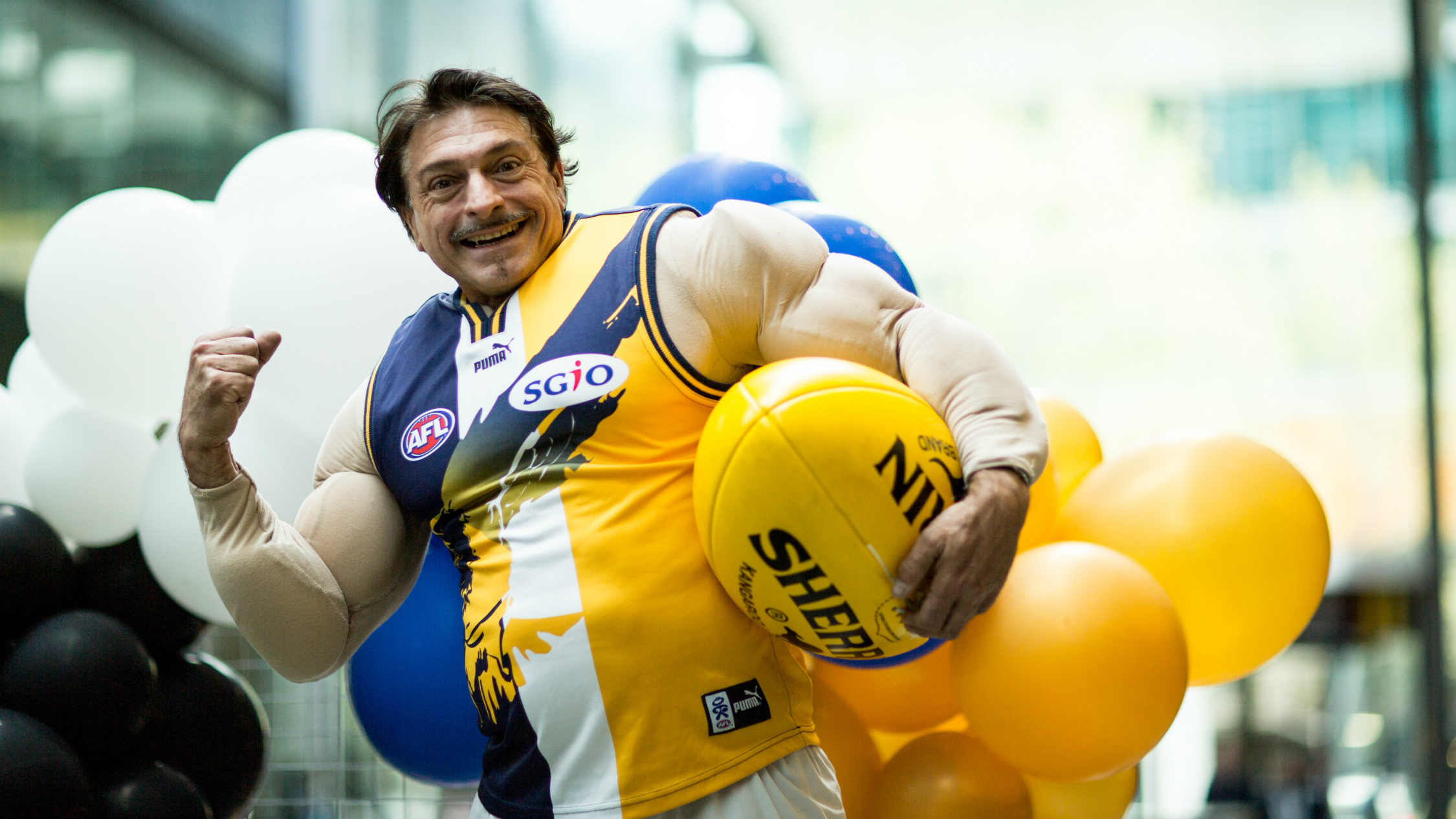 Man wearing a West Coast Eagles footy colours