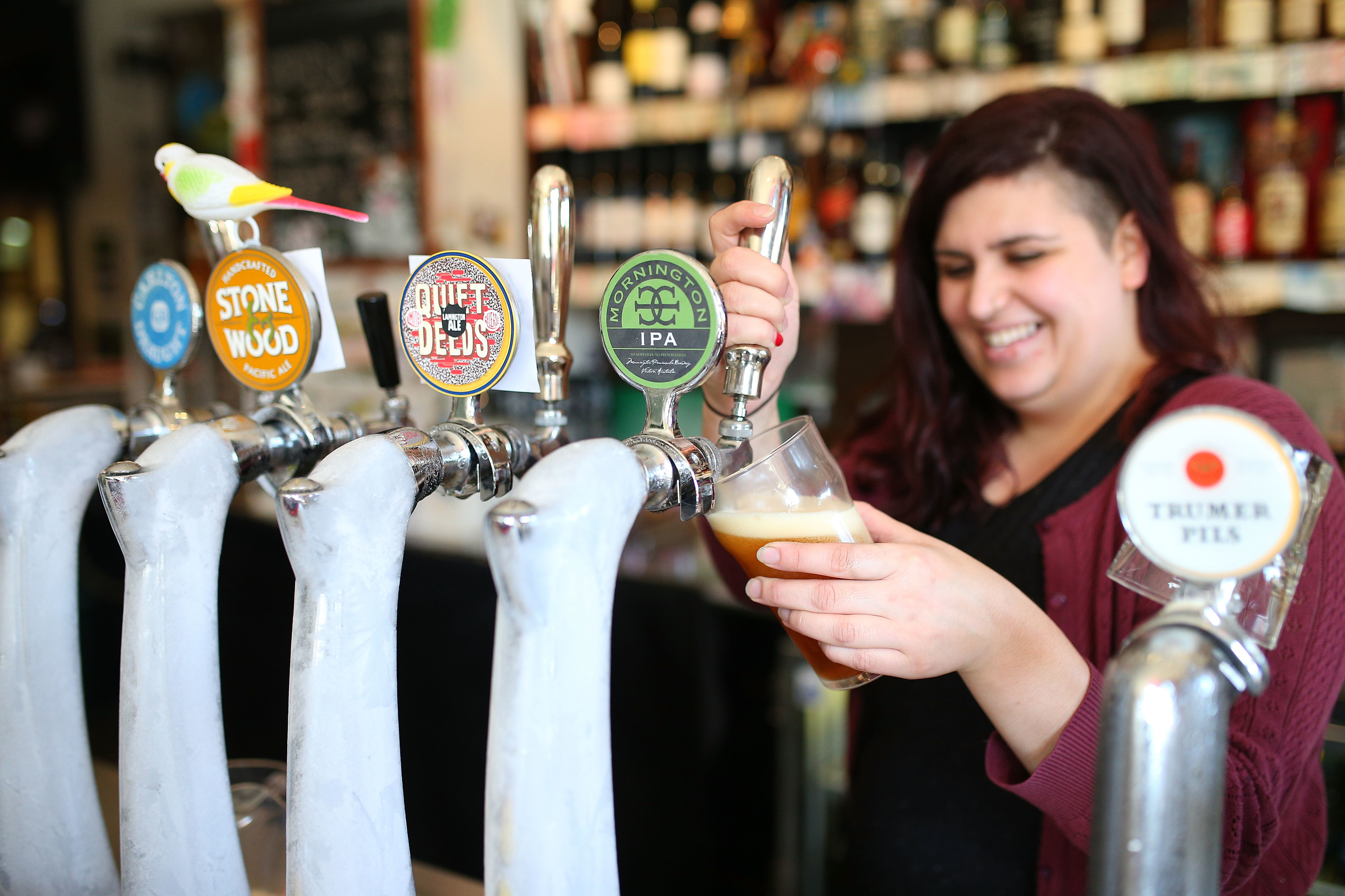 Bartender pouring a beer