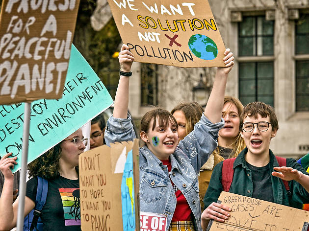 Young people carrying protest signs at a Global Climate Strike