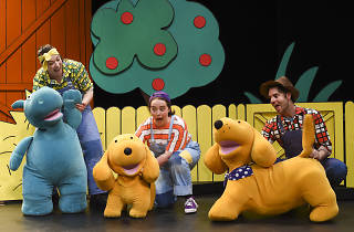 Performers hold up plush Spot toys