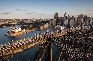 A group reach the peak of Sydney Harbour BridgeClimb