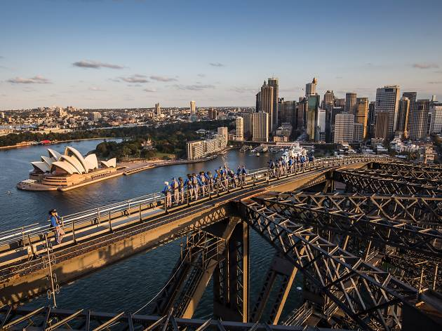 A group reach the peak of Sydney Harbour BridgeClimb