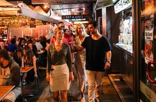 People dining at restaurants along Eat Street dining precinct in