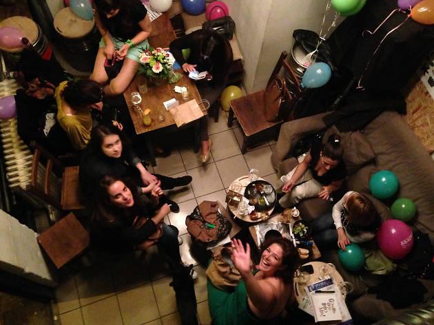 Looking down at guests at Fekete Kutya pub