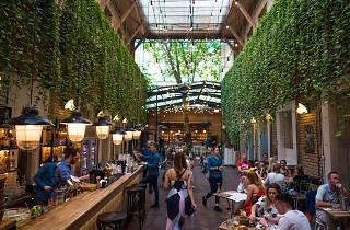 Inside the leafy Mazel Tov bar in Budapest