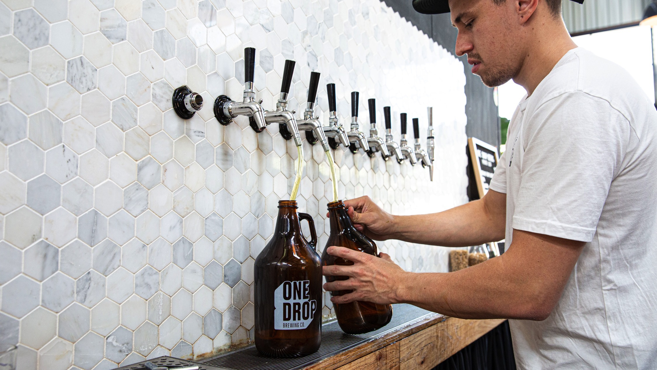 Pouring beer from tap at One Drop Brewery