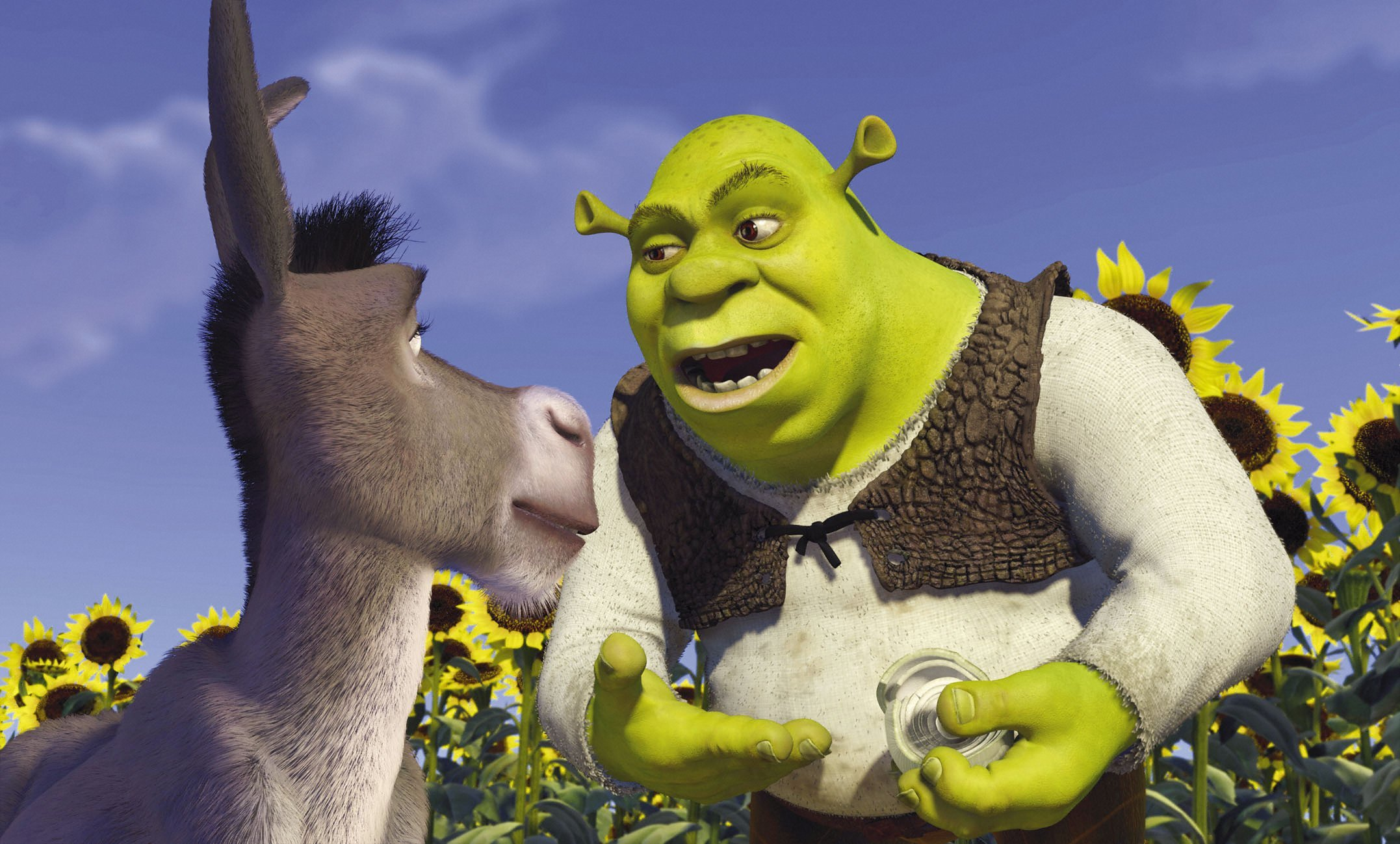 Picture shows: Donkey (voices by EDDIE MURPHY) and Shrek (voices by MIKE MYERS) standing in a sunflower field